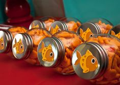 Goldfish in fish bowls to represent 'dorothy' from elmo's world is a fun idea.  I also like the straws with badges on them that are on this site.