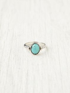 Lone Wolf Ring | Turquoise pendant ring in a silver foundation. Simple texturized silver band.  *By Spell & the Gypsy