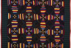 Windmill Blades Log Cabin Quilt.  Love this very dark pineapple quilt.