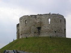 York Castle in the city of York, England, is a fortified complex comprising, over the last nine centuries, a sequence of castles, prisons, law courts and other buildings on the south side of the River Foss. The now-ruinous keep of the medieval Norman castle is commonly referred to as Clifford's Tower.