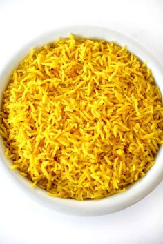 Add a Middle Eastern touch to any meal with this Israeli Yellow Rice as your side dish! Israeli yellow rice gets its color from turmeric which is known for it'shealth benefits. Serve as a side for steak, chicken, fish, and vegetable stir fries. Yellow Rice Recipe Middle Eastern, Middle Eastern Dishes, Middle Eastern Recipes, Lebanese Recipes, Jewish Recipes, Indian Food Recipes, Ethnic Recipes, Israeli Recipes, Halal Recipes