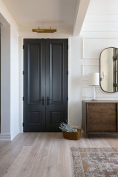 Doors interior - A welcoming front entry with wall panel details, black doors and picture light from a Rural Alberta Country House, Interior Design by Calgary Design Studio Nyla Free Designs Inc, Architecture Dejong Dark Doors, Grey Doors, Home Renovation, Black Interior Doors, Interior Door Colors, Interior Door Styles, Painted Interior Doors, Country Interior Design, Black Interior Design