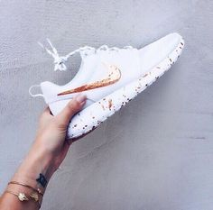 White Nikes with metallic swoosh