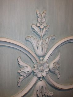 Detail of hand carved panel in two color hand glazed paint for a boiserie living room in NYC. Hand carved, manufactured & designed by Auffrance.