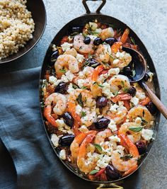 This colorful Mediterranean shrimp recipe brims with the flavors of feta, olives and oregano. To make it a party appetizer, serve it with a sliced baguette. colorful Mediterranean shrimp recipe brims with the flavors of feta, oliv Mediterranean Shrimp Recipe, Mediterranean Dishes, Mediterranean Appetizers, Shrimp Recipes, Fish Recipes, Recipes With Olives, Recipies, Clean Eating Snacks, Healthy Eating