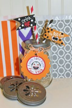 Daisy Cut Mason Jar Lids with Halloween sippy straws, straw flags and favor bags....