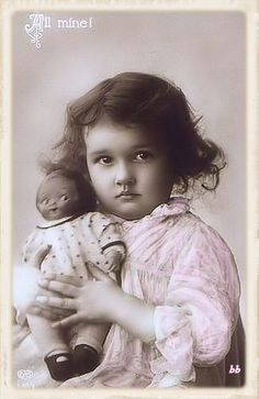 "Vintage photo of a little girl with her ""Dolly Dingle"" Doll."