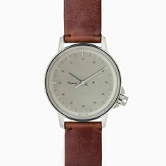 M12 SWISS STAINLESS-STEEL WATCH ON VINTAGE COGNAC LEATHER STRAP