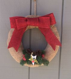 Country Christmas wreath. Wrapped in burlap with red bow.