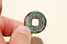 A 'Chun You Yuan Bao' (淳祐元寶) 2 cash coin with orthodox script, cast in 1243 AD during the 'Chun You' reign (1241-1252 AD) of Emperor Lizong (理宗) (1224–1264 AD), of the Southern Song (南宋) Dynasty (1127-1279 AD). The bottom of the reverse side features the Chinese number '3' indicating the coin was cast in the 3rd year of the 'Chun You' reign of Emperor Lizong.     28mm in size.  S-1013.
