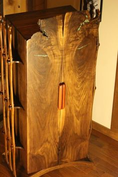 Solid Walnut Persian Style Armoire. The Doors Are Two Bookmatched Slabs  With Crushed Turquise And