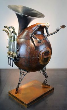 """Sounding the Furnace   2010 Size: 33 """" x 14 """" x 16 """"  Materials: Welded steel, concrete, french horn By Greg Brotherton"""
