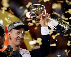 Denver Broncos' Peyton Manning holds up the trophy after winning Super Bowl 50 on Feb. 7, 2016, in Santa Clara, Calif.