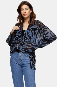 This all over tiger print oversized blue shirt nails animal print in a cool stylish way. We love the contemporary spin on dressing this piece takes. Topshop, Tiger Print, Swimwear Fashion, Printed Blouse, Style Guides, Mantel, Blouses For Women, Kimono, Stylish