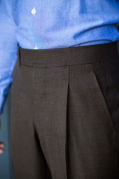 nice detailing, brown trousers and crisp blue shirt