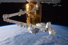 Science Image of the Day - August | Stuff.co.nz.    NASA In the grasp of the International Space Station's robotic Canadarm2, a piece of equipment is moved for installation on the Japan Aerospace Exploration Agency (JAXA) H-II Transfer Vehicle (HTV-3) currently docked to the space station.