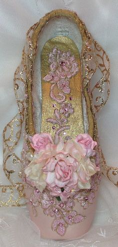 I+Pair+of+Pink+and+Gold+decorated+pointe+shoe.++
