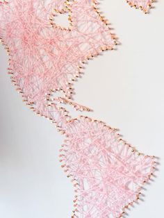 DIY: Oversized World Map String Art | HGTV >> http://www.hgtv.com/design/make-and-celebrate/handmade/make-an-oversized-world-map-string-art?soc=pinterest