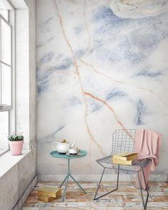 In love with marble? This texture wallpaper design is both elegant and timeless. Beautiful fiery bronze veins strike through this marble design, adding contrast to the blue. It's a match made in heaven with modern living room spaces.