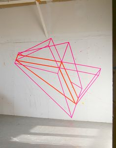 Example of large scale washi tape geometric designs for wall space. We will also project geometric shapes on the wall.