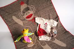 Our most popular gift over the last month for kids. Everyone is still crazy about Sock Monkeys!! This package brings together past and present by reviving your memories with retro themed sock monkeys to share with a new little monkey in your life.  We have included a cuddly throw blanket along with a small stuffed monkey and a cute little monkey inspired onsie and hat.  The package wouldn't be complete without the monkey's favourite treat: a banana themed toy.    This package…