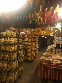 How about buying a traditional wooden shoe in Holland. Clogshoes are about 20€