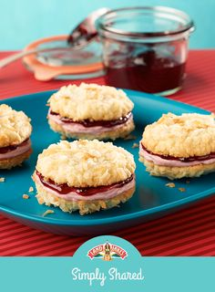 Tart blackberry cream sandwiched between two sweet coconut cookies is a unique flavor combination that's perfect for the holidays.