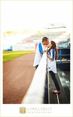 STEINBRENNER FIELD, Tampa, FL, Engagement Session, Limelight Photography, www.stepintothelimelight.com, portrait, couple, baseball, yankees, theme, photos, kiss
