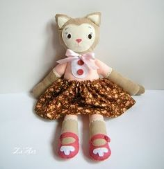 I have a book about a Kitty who picks out a doll just like this from when I was a little girl!