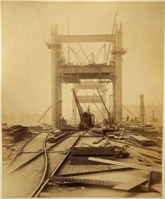 Photographs of Tower Bridge being constructed are found in a skip.