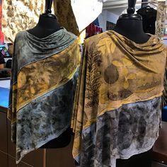Eco printed and indigo dyed and sewn ponchos.