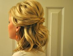 Lisa -- Half updo with some volume, and slight bump at the back crown.