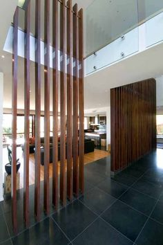 vertical wood room divider in foyer - Google Search