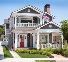 Street view of #AtLast in Coronado. The red front door really sets the tone before you even step inside.