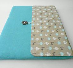 Laptop cover with buton fastening