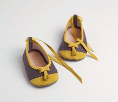 Linen and leather baby ballerinas with yellow bow and tassels by thesummerhouseshop. #HandmadeCharlotte