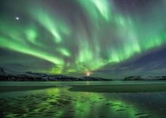 If you ever heard that a full moon means you can't see the northern lights, here's awesome proof to the contrary.