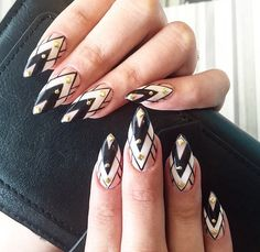 kellynewin on Instagram   Stilleto nails with a gorgeous geometric pattern, adorned with a few gems.  #nailart #negativespacenailart #geometricnails #naildesign #nails #manicure #style #nailtrends #fashion #dubaistyle #dubaifashion #dubai #uae