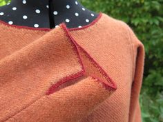 tablet woven finishing on handwoven 14th century dress By Mervi Pasanen