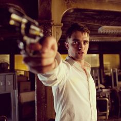 OMG. ROB WITH A GUN. Oh be still my heart! bahahhaha