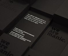 Business cards, hotstamped and silkscreened on a matte black paper _ by Singaporean studio Manic _