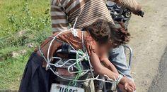 মেয়েকে মোটর সাইকেলে বেঁধে স্কুলে নেয়ায় বাবা গ্রেফতার