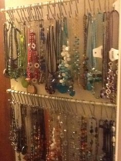 I finally tried a Pinterest suggestion and organized my necklaces so I'll use them   Hung 2 cafe rods and used ikea hooks