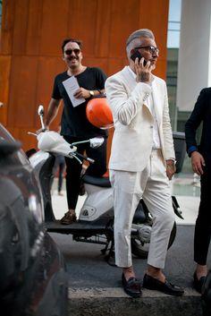 Shop this look on Lookastic:  https://lookastic.com/men/looks/beige-suit-white-dress-shirt-black-leather-tassel-loafers/12173  — White Dress Shirt  — Beige Suit  — Black Leather Tassel Loafers