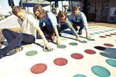 Imagine Dragons playing imagine twister. Dan has an advantage with his long legs...But Wayne and Ben could use their hair as a third arm:D Platz... Maybe that unicorn horn will come in soon