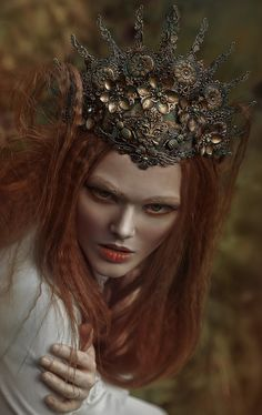 Different take on a crown... more of a headdress, sitting further on the forehead  Agnieszka Lorek (A.M. Lorek Photography)