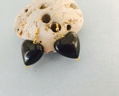 A personal favorite from my Etsy shop https://www.etsy.com/listing/89655988/black-heart-earrings-vintage-inspired