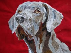 """Textile art by Chrissie Davies: Chrissie Davies, """"Arlo, the pointer"""" 2014. 45cm x45cm. Free form machine embroidery and fabric collage."""