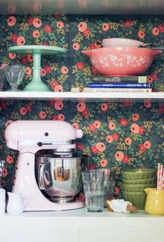 Rifle Paper wallpaper behind pantry shelves - DIY for the Lazy: 6 Cute Projects from Apartment Therapy/// how weird is it, that I have the loveless cafe cookbook, the pink kitchenaid, & the pink Pyrex bowl. Rental Decorating, Decorating Tips, Home Decor Trends, Diy Home Decor, Cocinas Kitchen, Diy Playbook, Cabinet Makeover, Door Makeover, Kitchen On A Budget