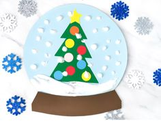 A Winter Themed Puffy Paint Snowglobe Craft For Kids Bring the winter theme inside with this fun puffy paint snowglobe craft for kids. This simple winter craft is great for doing at home or in the classroom! Christmas Art Projects, Christmas Trees For Kids, Beautiful Christmas Decorations, Winter Crafts For Kids, Crafts For Kids To Make, Kids Crafts, Christmas Crafts, Craft Kids, Elegant Christmas
